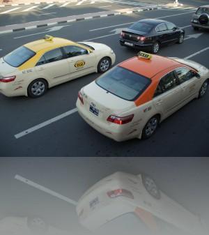 Такси разных компаний имеют разный цвет, но низ у всех един